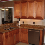 Maple kitchen with raised panel applied molding doors and 5-piece drawer fronts after