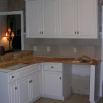 Maple kitchen with raised panel applied molding doors and drawer fronts before