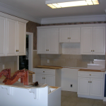 Maple kitchen with raised panel applied molding doors and 5-piece drawer fronts before